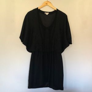 Black short dress, dry clean only.